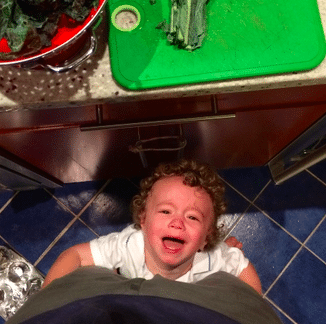 A child holding onto its dad's legs whining endlessly and crying without purpose, ultimately breaking down the father's soul...even as he's trying to build the company making the best diaper bags for dads