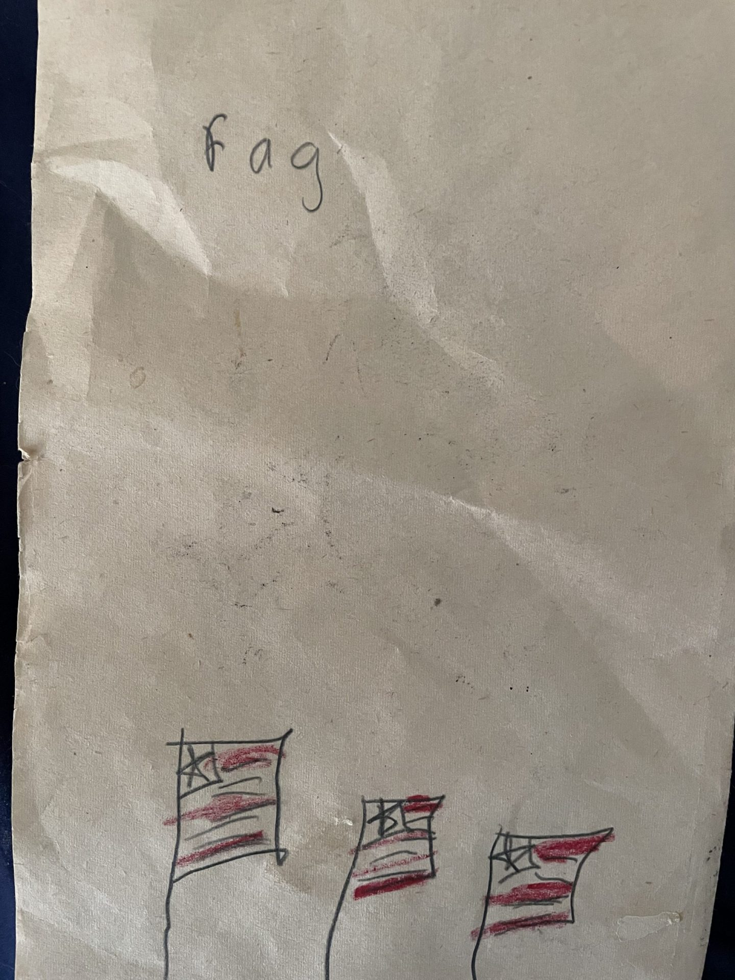 """4 yo child's picture of flags and labeled """"fag"""""""